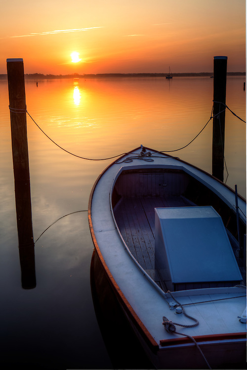 boat docked at sunrise at the st michaels dock