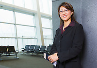 Businesswoman waiting at airport gate&#xA;<br />