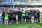 Manchester City Women players and staff huddle during the FA Women's Super League match between Manchester City Women and Manchester United Women at the Sport City Academy Stadium, Manchester, United Kingdom on 7 September 2019.