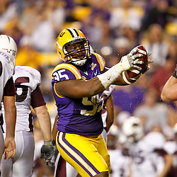 November 13, 2010; Baton Rouge, LA, USA; LSU Tigers defensive tackle Lazarius Levingston (95) celebrates after recovering a Louisiana Monroe Warhawks fumble during the first half at Tiger Stadium.  Mandatory Credit: Derick E. Hingle