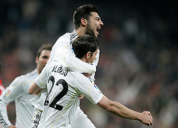 MADRID, SPAIN - Sunday, March 28, 2010: Real Madrid Club de Futbol's Xabi Alonso celebrates scoring against Club Atletico de Madrid with team-mate Raul Albiol during the La Liga Primera Division Madrid Derby match at the Estadio Santiago Bernabeu. (Pic by Hoch Zwei/Sprimont Press/Propaganda)