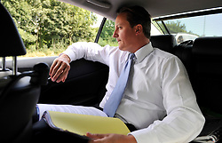 Leader of the Conservative Party David Cameron working in the back of his car  while on a 3 day tour of Yorkshire and the North West of England, Wednesday August 19, 2009. Photo By Andrew Parsons / i-Images.