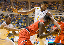 West Virginia Mountaineers forward Jonathan Holton (1) tries to steal the ball against the Texas Tech Red Raiders during the first half at the WVU Coliseum.