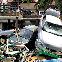 Pile of Crashed Cars After Tsunami on Patong Beach in Phuket, Thailand <br />