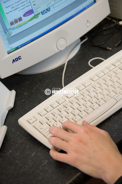 Close up of student using keyboard of a computer; Sycamore Centre Nottingham,