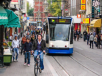 Holland, Netherlands, street scene, Amsterdam, cyclist, tram, 200710050085.<br />