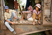 01 JULY 2006 - PHNOM PENH, CAMBODIA: Passengers sit on the floor and in hammocks they bring with them when they ride in the boxcar on the Phnom Penh - Battambang train. While much of Cambodia's infrastructure has been rebuilt since the wars which tore the country apart in the late 1980s, the train system is still in disrepair. There is now only one passenger train in the country. It runs from Phnom Penh to the provincial capitol Battambang and it runs only one day a week. It takes 12 hours to complete the 190 mile journey.  Photo by Jack Kurtz / ZUMA Press