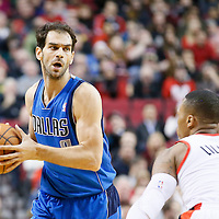 07 December 2013: Dallas Mavericks point guard Jose Calderon (8) looks to pass the ball over Portland Trail Blazers point guard Damian Lillard (0) during the Dallas Mavericks 108-106 victory over the Portland Trail Blazers at the Moda Center, Portland, Oregon, USA.