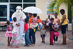 The Easter Bunny visits with children.  Easter Sunday Extravaganza at Crown Bay Center.  St. Thomas, VI.  5 April 2015.  © Aisha-Zakiya Boyd
