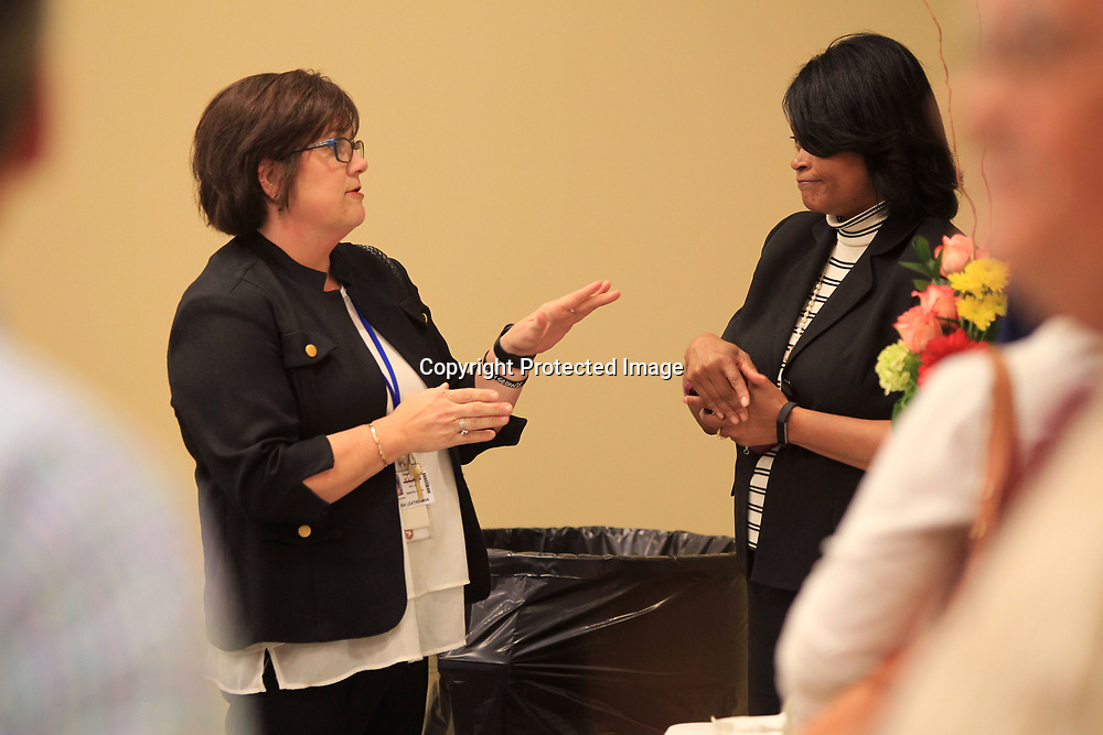 Lisa Leatherman, an administrative intern at Saltillo Elementary School, talks with Debbie Jones the testing coordinator for the Lee County School District, during a retirement reception for Lee County School District employees and faculty on Tuesday afternoon in Tupelo.