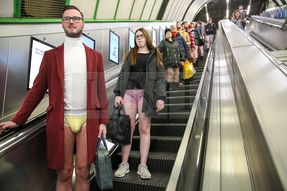 © Licensed to London News Pictures. 12/01/2020. London, UK. People take part in the 11th 'No Trousers Tube Ride' event on the London underground without wearing trousers. The 'No Pants Subway Ride is an annual event staged by Improve Everywhere, every January in New York City. The mission started as a small prank with seven guys participating, and has grown into an international celebration of silliness, with dozens of cities around the world, including London, taking part each year. Photo credit: Dinendra Haria/LNP