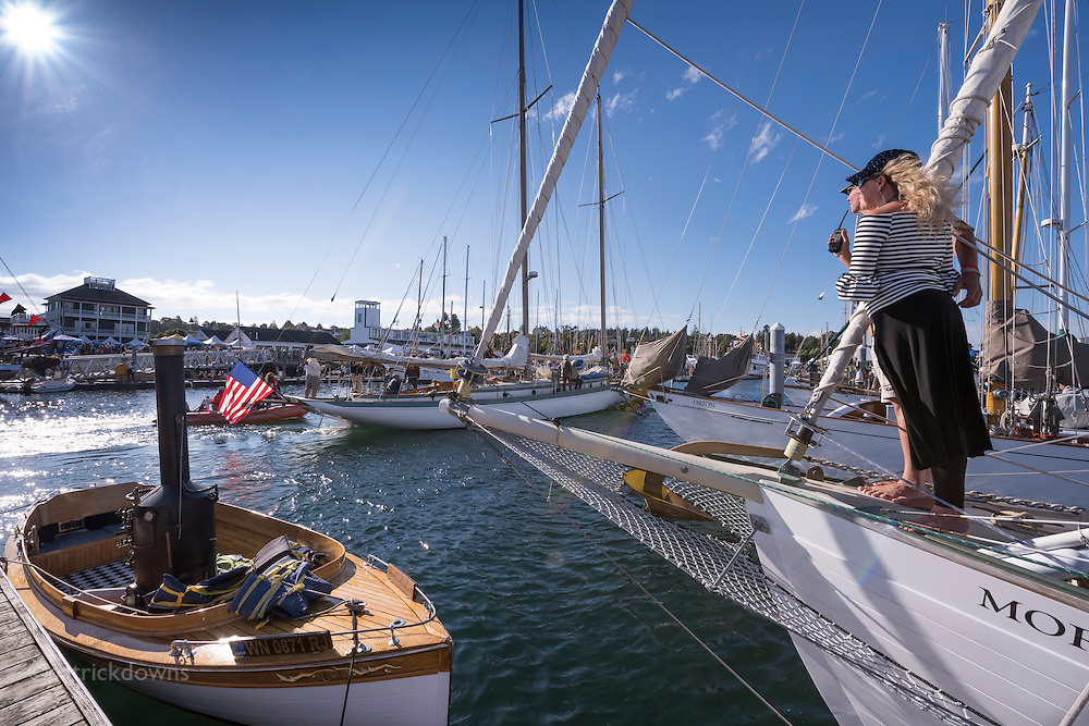 Wooden Boat Festival: A couple aboard the MorningStar watch as schooner Martha comes back in after the schooner race at the festival.