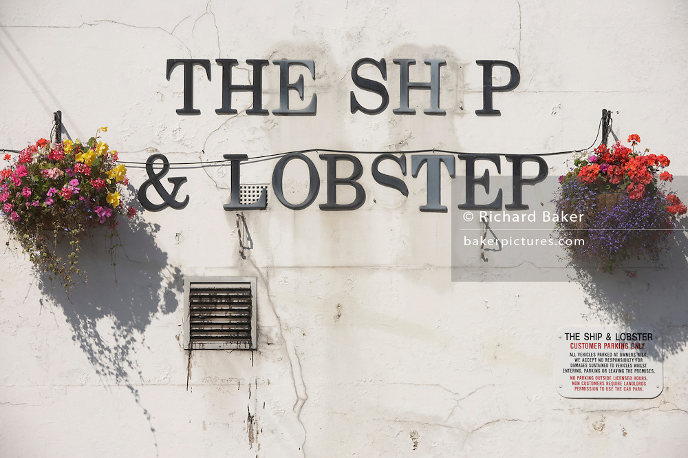 Fading name of the Ship and Lobster, an 1832 Dickensian pub reflecting the Victorian shellfish trade on the Thames