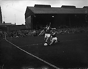 28/09/1960<br /> 09/28/1960<br /> 28 September 1960<br /> Soccer International: Ireland v Wales at Dalymount Park, Dublin. Wales won the game 3-2. Cliff Jones, Welsh outside left slips tackle by Irish full back Phil Kelly.