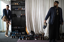 © Licensed to London News Pictures . 12/05/2017 . Manchester , UK . Mourners remove their shoes as they enter the mosque . Thousands of people fill a mosque , inside a marquee at the British Muslim Heritage Centre in Whalley Range , Manchester , for the funeral of Mawlana Habib-ur-Rahman , at the British Muslim Heritage Centre , Whalley Range , Manchester . Rahman , a former maths teacher and then imam at Manchester Central Mosque , died aged 90 following heart problems . As a well-known leader of Manchester's Muslim community he promoted interfaith dialogue and met the Pope during a Papal visit to Manchester in 1982 . Due to the number attending , crowds attending the funeral had to be diverted to rooms in nearby buildings to listen to the service via loudspeaker . Photo credit : Joel Goodman/LNP