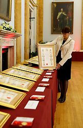The Lord Mayor of Liverpool Roz Gladden with one of the scrolls at Liverpool Town Hall, which are to be given to families of the victims of the Hillsborough disaster when they receive the Freedom of the City tomorrow.
