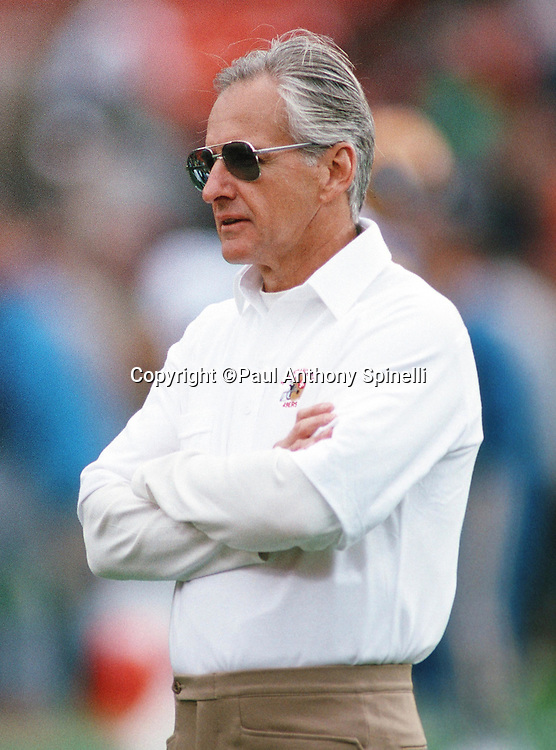 San Francisco 49ers head coach George Seifert watches pregame warmups before the NFL NFC Championship playoff football game against the Los Angeles Rams on Jan. 14, 1990 in San Francisco. The 49ers won the game 30-3. (©Paul Anthony Spinelli)