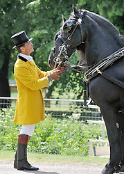 © under license to London News Pictures. WINDSOR, UK  13/05/2011.A footman checks his horses ahead of The Carriage Marathon. The Royal Windsor Horse Show in the grounds of Windsor Castle today (13 May 2011). Photo credit should read Stephen Simpson/LNP.