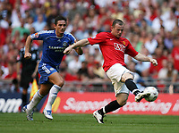 Photo: Rich Eaton.<br /> <br /> Manchester United v Chelsea. FA Community Shield. 05/08/2007. Man United's Wayne Rooney (r) gets to the ball ahead of Chelsea's Frank Lampard.