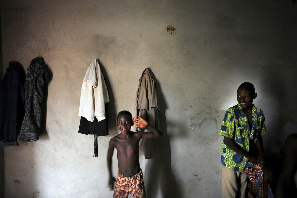 African boys playing inside of their room  in Cotonou, Benin February 29, 2008.