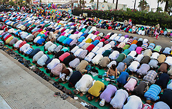 Image ©Licensed to i-Images Picture Agency. 28/07/2014. Alexandria,  Egypt. <br /> 61981779<br /> Muslims pray outside a mosque in Alexandria, costal city of Egypt, on July 28, 2014. Egyptian Muslims on Monday celebrate the Eid al-Fitr festival that marks the end of the fasting month of Ramadan. Picture by  imago / i-Images<br /> UK ONLY