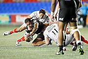 Widnes' Hep Cahill and Chris Houston wrestle Hull's Fetuli Talanoa to the floor during the Super 8s Round 2 match between Widnes Vikings and Hull FC at the Select Security Stadium, Halton, United Kingdom on 11 August 2016. Photo by Craig Galloway.