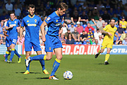 AFC Wimbledon defender Paul Robinson (6) passing the ball and starting an attack from defence during the EFL Sky Bet League 1 match between AFC Wimbledon and Bristol Rovers at the Cherry Red Records Stadium, Kingston, England on 8 April 2017. Photo by Matthew Redman.