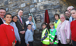 Minister for Transport Noel Dempsey and Cllr Myles Staunton Cathaoirleach Westport Town Council get help from local primary school kids to unveil a  plaque to marking the opening of Westport's Greenway on the Railwalk on friday last ...Pic Conor McKeown