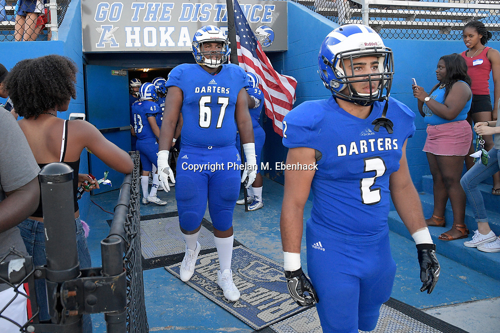 Apopka captains Chance Bush (2) and Will Barnes (67) walk onto the field before a spring high school football game against Orange City University in Apopka, Fla., Thursday, May 25, 2017. (Photo by Phelan M. Ebenhack)