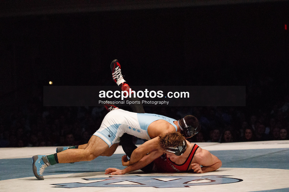2017 January 23: North Carolina Tar Heels during a match against the North Carolina State Wolfpack at Memorial Hall in Chapel Hill, NC. NCSU won 19-11.<br /> <br /> 174: #7 Ethan Ramos (UNC) dec. Nick Reenan (NCSU), 11-4
