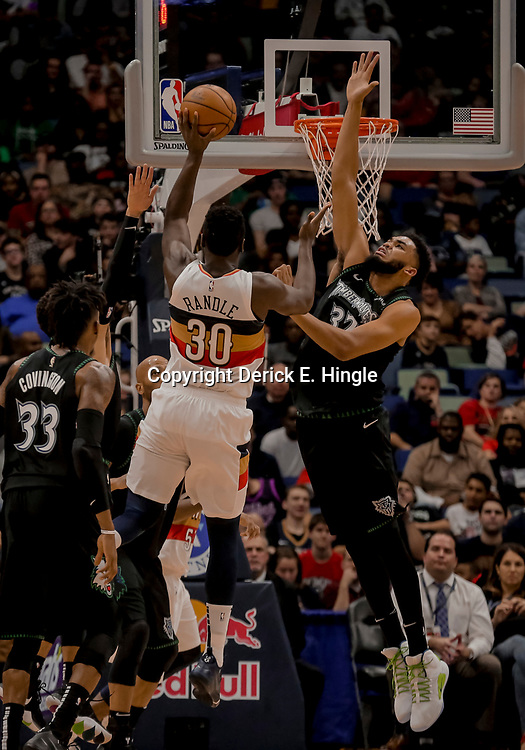 Dec 31, 2018; New Orleans, LA, USA; Minnesota Timberwolves center Karl-Anthony Towns (32) defends New Orleans Pelicans forward Julius Randle (30) during the first quarter at the Smoothie King Center. Mandatory Credit: Derick E. Hingle-USA TODAY Sports