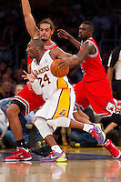 25 December 2011: Guard Kobe Bryant of the Los Angeles Lakers drives to the basket while being guarded by Joakim Noah and Luol Deng of the Chicago Bulls during the first half of the Bulls 88-87 victory over the Lakers at the STAPLES Center in Los Angeles, CA.