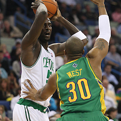 Feb 10, 2010; New Orleans, LA, USA; Boston Celtics forward Kevin Garnett (5) is defended by New Orleans Hornets forward David West (30) during the first quarter at the New Orleans Arena. Mandatory Credit: Derick E. Hingle-US PRESSWIRE