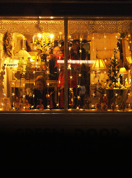 A view into a shop window at night time