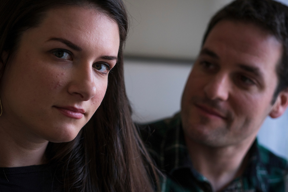 "Fredericksburg, VA  - Lindsey and Matt Paradiso, photographed inside their home, March 12, 2017 in downtown Fredericksburg, Virginia.  Lindsey, 28 years old, and Matt, 31 years old, talk about their pregnancy and subsequent ""late term abortion"" due to medical complications. Omara Rose, the name the chose for their daughter, was aborted at 25 weeks, February 26, 2016. Photo Justin Ide"