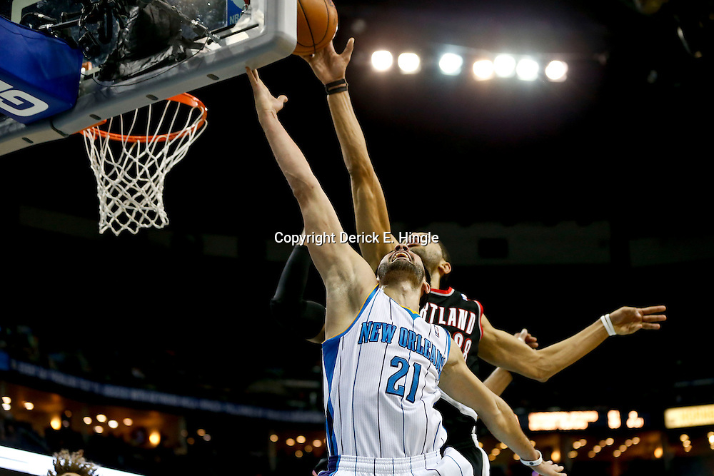 Feb 13, 2013; New Orleans, LA, USA; New Orleans Hornets point guard Greivis Vasquez (21) has a shot blocked by Portland Trail Blazers small forward Nicolas Batum (88) during  the second quarter of a game at the New Orleans Arena. Mandatory Credit: Derick E. Hingle-USA TODAY Sports