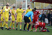 Accrington Stanley midfielder Sam Finley (14) receives attention during the EFL Sky Bet League 1 match between Accrington Stanley and Fleetwood Town at the Fraser Eagle Stadium, Accrington, England on 30 March 2019.