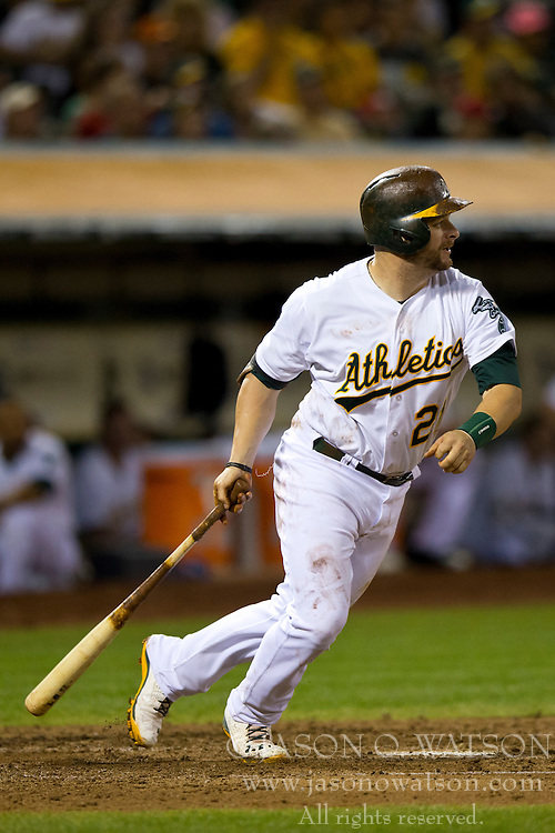 OAKLAND, CA - SEPTEMBER 23:  Stephen Vogt #21 of the Oakland Athletics at bat against the Los Angeles Angels of Anaheim during the fourth inning at O.co Coliseum on September 23, 2014 in Oakland, California. The Los Angeles Angels of Anaheim defeated the Oakland Athletics 2-0.  (Photo by Jason O. Watson/Getty Images) *** Local Caption *** Stephen Vogt
