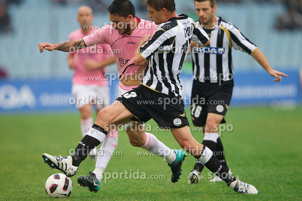 Pinilla Mauricio Ricardo Ferrera of Palermo vs Andrea Coda of Udinese  during football match between Udinese Calcio and Palermo in 8th Round of Italian Seria A league, on October 24, 2010 at Stadium Friuli, Udine, Italy.  Udinese defeated Palermo 2 - 1. (Photo By Vid Ponikvar / Sportida.com)