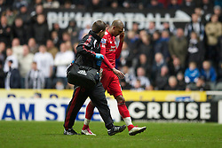 NEWCASTLE, ENGLAND - Saturday, December 11, 2010: Liverpool's David Ngog leaves the field with a head injury during the Premiership match against Newcastle United at St James' Park. (Photo by: David Rawcliffe/Propaganda)