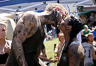 Rachel Grebner of Centerville (right,) a member of the Fricker's team, sends boyfriend David Durrant of Centerville off to another team with a muddy kiss during MuddyGras, the 20th annual mud volleyball for Epilepsy at Wegerzyn Gardens MetroPark in Dayton, Saturday, July 10, 2010.