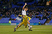 Marcus Forss of Wimbledon goes to ground under a challenge from Sid Nelson of Tranmere Rovers  during the EFL Sky Bet League 1 match between Tranmere Rovers and AFC Wimbledon at Prenton Park, Birkenhead, England on 21 December 2019.