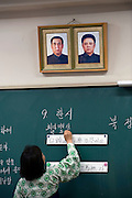 "Portraits of Kim Il-Sung, the man revered as North Korea's  ""Great Leader"", and his son, ""Dear Leader"" Kim Jong-Il, hang over the blackboard during a Korean Language class at the Tokyo Korean High School in Tokyo, Japan on Thursday 07 October, 2010..Photographer: Robert Gilhooly"