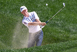 June 24, 2017 - Cromwell, Connecticut, U.S - Mackenzie Hughes hits out of the trap on the 15th hole during the third round of the Travelers Championship at TPC River Highlands in Cromwell, Connecticut. (Credit Image: © Brian Ciancio via ZUMA Wire)