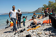 Refugees from Syria arrive in overladen rubber dinghy on the Greek Island of Chios. The 60 occupoants of the boat arrived after 5 hours at sea and three days on foot relieved and happy to set foot on European soil after a harrowing escape from the fighting inSyria. Chios, Greece.