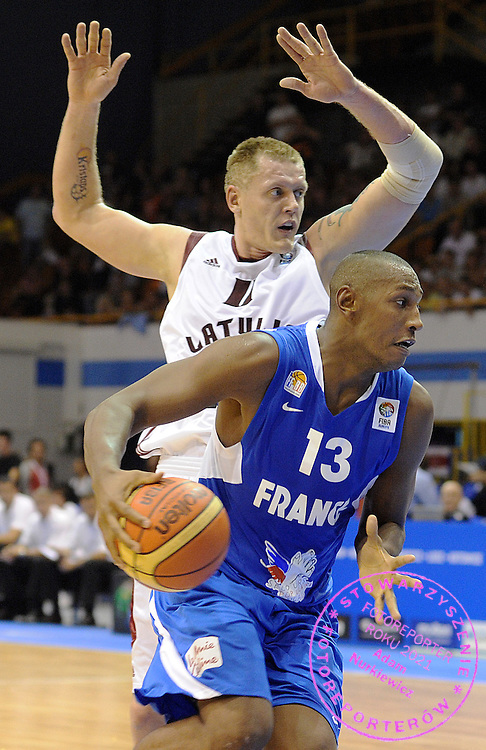 (R) Boris Diaw of France is marked by Kaspars Kambala of Latvia during the EuroBasket 2009 Group B match between France and Latvia on September 8, 2009 in Gdansk, Poland.  ( Photo by Adam Nurkiewicz / Mediasport )