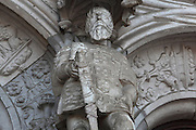 Statue of Henry the Navigator, 1394-1460, with sword and armour, on the South Portal, 1516-18, by Joao de Castilho, 1470ñ1552, after a design by Diogo de Boitaca, Church of Santa Maria, at the Jeronimos Monastery or Hieronymites Monastery, a monastery of the Order of St Jerome, built in the 16th century in Late Gothic Manueline style, Belem, Lisbon, Portugal. The portal consists of double doors with a tympanum carved with scenes from the life of St Jerome, a statue of Henry the Navigator, many carved statues in niches, a statue of the Madonna and many flamboyant pinnacles and gables in Manueline style. The monastery is listed as a UNESCO World Heritage Site. Picture by Manuel Cohen
