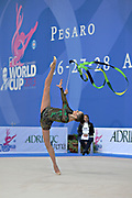 Alina Maksimenko during final at ribbon in the Pesaro World Cup at the Adriatic Arena on 28 April, 2013.<br /> Alina is an Ukrainian individual rhythmic gymnast. She was born on July 10, 1991 in Zaporizhia, Ukraine.
