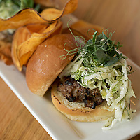 Wrightsville Beach Brewery -<br /> <br /> Lamb and beef sliders-<br /> <br /> Ground beef blended with ground lamb, green peppers, onions grilled served on challah roll with fennel slaw and pea tendrils