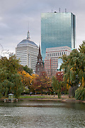 USA, Massachusetts, Boston. Boston Public Garden Hancock Tower in the background in Autumn